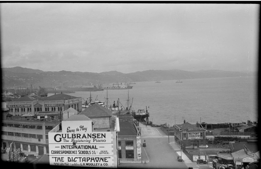 Wellington city scene including the intersection of Taranaki and Cable Streets. Just, F R :Two albums of photographs and captions relating to the Just family and 119 negatives taken by his father in the 1920s and 1930s of around Wellington and the Bell Bus Company. Ref: 1/2-071478-F. Alexander Turnbull Library, Wellington, New Zealand. http://natlib.govt.nz/records/23117809