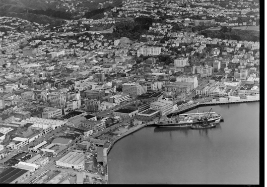 Wellington Harbour southern wharf area with Cable and Taranaki Streets and city, with Kelburn Park and Victoria University, Wellington City. Whites Aviation Ltd :Photographs. Ref: WA-40792-G. Alexander Turnbull Library, Wellington, New Zealand. http://natlib.govt.nz/records/30113905